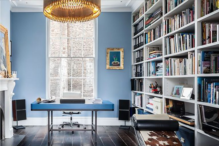 Masculine large home office room inspiration with baby blue walls and mid-century furniture