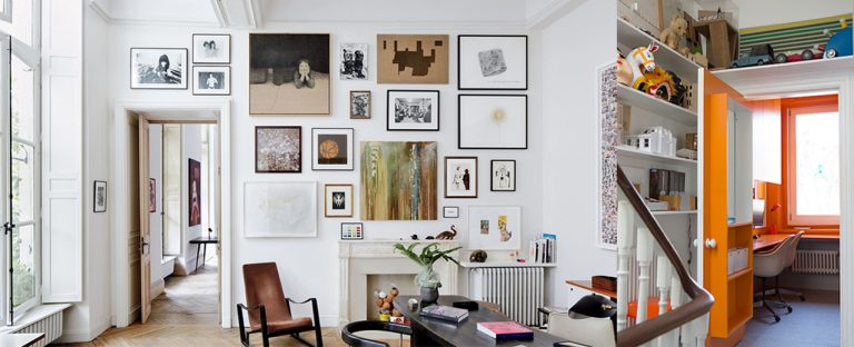 Hidden micro-home office inspiration with bold orange decor or picture hanging styling